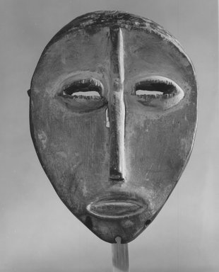 Lega. Mask (Lukwakongo), late 19th or early 20th century. Wood, kaolin, pigment, fiber, 7 1/2 x 5 x 1 3/4 in. (19.1 x 12.7 x 4.6 cm). Brooklyn Museum, Gift of Marcia and John Friede, 74.121.6. Creative Commons-BY