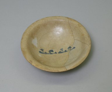 Blue and White Bowl with Kufic Inscription, 9th century. Ceramic; earthenware, painted in cobalt blue on an opaque white glaze., height: 1 5/16 in. (3.3 cm); diameter: 5 3/16 in. (13.2 cm). Brooklyn Museum, Gift of Ernest Erickson, 74.195. Creative Commons-BY