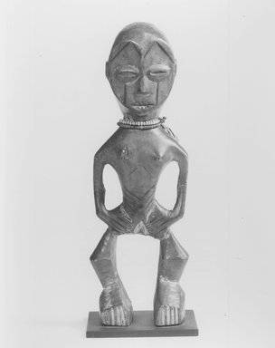 Lega. Figure (Iginga), late 19th or early 20th century. Wood, plastic beads, 11 x 3 3/4 x 2 1/2 in. (27.9 x 9.5 x 6.4 cm). Brooklyn Museum, Gift of Marcia and John Friede, 74.66.1. Creative Commons-BY