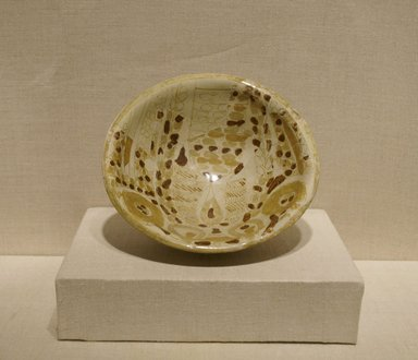 Bowl with Abstract Foliate Design, 9th century. Ceramic; earthenware, painted in luster on an opaque white glaze, 2 1/8 x 7 1/8 x 7 1/8 in. (5.4 x 18.1 x 18.1 cm). Brooklyn Museum, Gift of Mr. and Mrs. Carl L. Selden, 74.78. Creative Commons-BY
