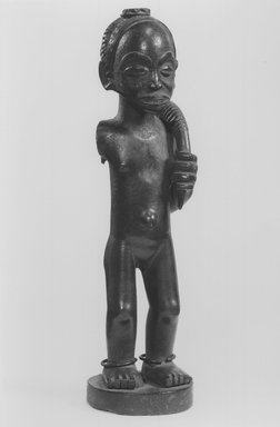 Chokwe. Female Figure with Horn (Kaponya), late 19th century. Wood, copper alloy, 12 1/4 x 3 1/2 x 3 1/4 in. (31.1 x 8.9 x 8.3 cm). Brooklyn Museum, Gift of Marcia and John Friede, 74.89. Creative Commons-BY