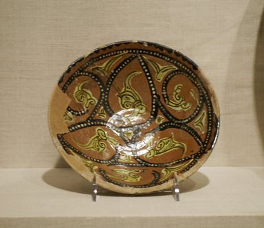 Bowl with Abstract Foliate Design, 10th century. Ceramic; earthenware, painted in black, yellow, and white slip on a red slip ground under a transparent glaze, 2 1/2 x 8 1/4 in. (6.3 x 21 cm). Brooklyn Museum, Gift of Mr. and Mrs. Charles K. Wilkinson, 75.117.1. Creative Commons-BY