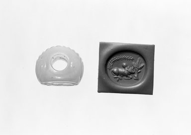 Ancient Near Eastern. Stamp Seal: Recumbent Humped Bull with Tree and Leafy Branch, 3rd-7th century C.E. Chalcedony, 13/16 x 3/4 x 13/16 in. (2.1 x 1.9 x 2 cm). Brooklyn Museum, Designated Purchase Fund, 75.55.10. Creative Commons-BY