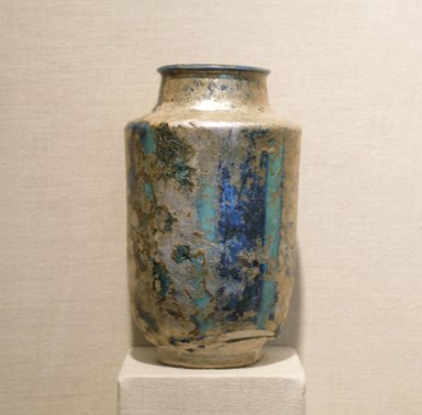 Albarello, 13th century. Ceramic; fritware, painted in cobalt blue under a transparent turquoise glaze; heavy iridescence, 6 1/8 x 4 1/16 in. (15.5 x 10.3 cm). Brooklyn Museum, Gift of Leon Pomerance, 75.8. Creative Commons-BY