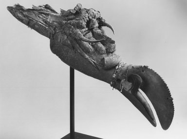Mau. Koma Ba Mask, late 19th-early 20th century. Wood, cowrie shells, metal, feathers, horns, leather, fiber, sacrificial materials, 41 x 11 x 11 in. (104.1 x 27.9 x 27.9 cm). Brooklyn Museum, Gift of Marcia and John Friede, 76.20.2. Creative Commons-BY