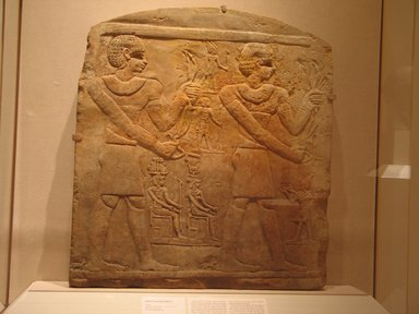 Egyptian. Round-Topped Stela with Nine Figures, late 1st century B.C.E.-early 1st century C.E. Sandstone, 34 5/16 x 31 7/16 x 4 5/16 in. (87.2 x 79.9 x 10.9 cm) Measurements: H. 87.2 cm., w. 79.9 cm., th. 10.9 cm. Brooklyn Museum, Charles Edwin Wilbour Fund, 76.8. Creative Commons-BY
