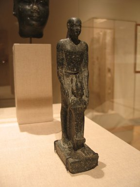 Statuette of Hor, Son of Pawen, ca. 399-380 B.C.E. Mottled granite, 7 5/16 x 1 3/4 x 2 11/16 in. (18.5 x 4.5 x 6.8 cm). Brooklyn Museum, Charles Edwin Wilbour Fund, 77.50. Creative Commons-BY