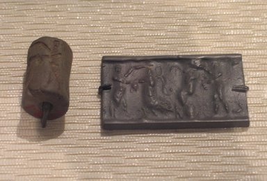 Ancient Near Eastern. Cylinder Seal: Combat Scene, ca. 2255-2154 B.C.E. Serpentine, 1 3/16 x Diam. 3/4 in. (3 x 1.9 cm). Brooklyn Museum, Special Hagop Kevorkian Grant Fund, 77.52.1. Creative Commons-BY