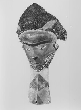 Pende (Western). Mask (Mbuya) with Long Beard (Kiwoyo-Muyombo), 19th or 20th century. Wood, pigment, raffia, fiber, 16 x 7 1/2 x 14 1/4 in. (40.6 x 19.0 x 36.3 cm). Brooklyn Museum, Gift of Mr. and Mrs. J. Gordon Douglas III, 78.115.3. Creative Commons-BY