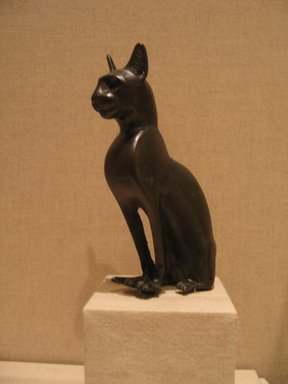 Statuette of a Seated Cat, ca. 664-342 B.C.E. Bronze, 5 1/4 x 1 5/8 x 3 3/4 in. (13.3 x 4.1 x 9.5 cm). Brooklyn Museum, Gift of Mrs. Nasli Heeramaneck, 78.243. Creative Commons-BY