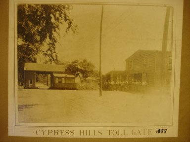 American. Cypress Hills Toll Gate, 1888. Photograph in sepia, sheet: 7 x 8 5/8 in.  (17.8 x 21.9 cm);. Brooklyn Museum, Gift of Herbert D. Wallace, 79.107.3