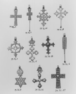 Amhara. Pendant Cross with Ear Cleaner Extension, 19th or 20th centuries. Silver, 2 1/2 x 1 1/2 in. (6.3 x 3.8 cm). Brooklyn Museum, Gift of George V. Corinaldi Jr., 79.72.3. Creative Commons-BY