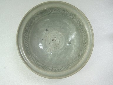 Bowl, 14th - 15th century. Stoneware with olive-green glaze, 3 5/8 x 11 1/4 in. (9.2 x 28.6 cm). Brooklyn Museum, Gift of Dr. Jerome Krieger, 80.270.3. Creative Commons-BY