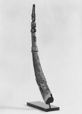 Kongo (Yombe subgroup). Side-Blown Horn (Mpungi) or (Kithenda), 19th century. Ivory, fiber, cloth, 28 x 3 in. (diam.) (71.1 x 7.6 cm). Brooklyn Museum, Gift of The Roebling Society, 80.32. Creative Commons-BY