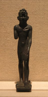 Egyptian. Figure of a Kushite King, ca. 712-653 B.C.E. Bronze, 4 13/16 x 1 1/8 x 1 3/4 in. (12.2 x 2.8 x 4.5 cm). Brooklyn Museum, Charles Edwin Wilbour Fund, 81.184. Creative Commons-BY
