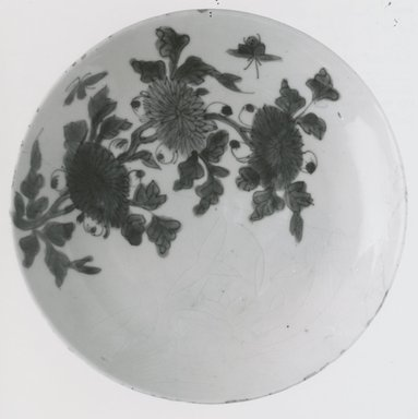 Plate, late 16th-early 17th century. Porcelain with cobalt-blue underglaze decoration, 1 7/16 x 8 1/8 in. (3.7 x 20.6 cm). Brooklyn Museum, Gift of Dr. John P. Lyden, 81.296.2. Creative Commons-BY