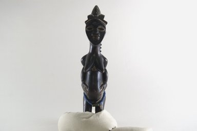 Kulango. Female Figure, early 20th century. Wood, glass beads , 11 in. (27.9 cm). Brooklyn Museum, Gift of Mr. and Mrs. Brian S. Leyden, 82.214. Creative Commons-BY
