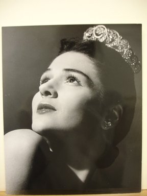Philippe Halsman (American, born Latvia, 1906-1979). [Untitled]  (Brunette Woman Looking Up to the Left Wearing Tiara), 1944. Gelatin silver photograph Brooklyn Museum, Gift of Dr. and Mrs. Arthur E. Kahn, 85.294.17. © Halsman Archive