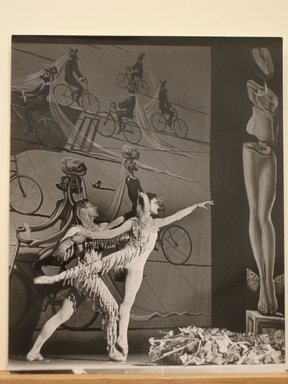 Philippe Halsman (American, born Latvia, 1906-1979). [Untitled]  (Male and Female Ballet Dancers in Front of Painting of Men on Bicycles), 1944. Gelatin silver photograph Brooklyn Museum, Gift of Dr. and Mrs. Arthur E. Kahn, 85.294.28. © Halsman Archive