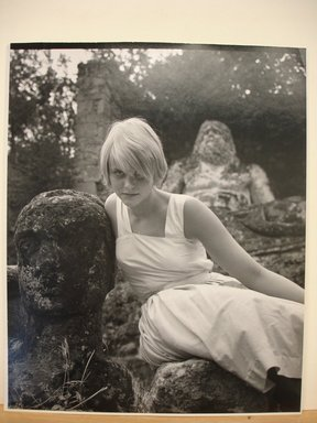 Philippe Halsman (American, born Latvia, 1906-1979). Swedish Model (Blonde Woman in White Dress Leaning Against Statue of a Head). Gelatin silver photograph Brooklyn Museum, Gift of Dr. and Mrs. Arthur E. Kahn, 85.294.6. © Halsman Archive