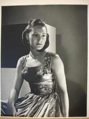 Philippe Halsman (American, born Latvia, 1906-1979). [Untitled] (Brunette Woman Looking to Right, Wearing Dress with Sequined Straps and Waist). Gelatin silver photograph Brooklyn Museum, Gift of Dr. and Mrs. Arthur E. Kahn, 85.294.8. © Halsman Archive