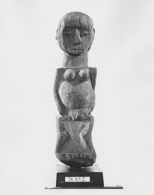 Fon. House Guardian Figure (Bochio), late 19th or early 20th century. Wood, 25 x 7 in. (63.5 x 17.8 cm). Brooklyn Museum, Gift of Dr. and Mrs. Abbott A. Lippman, 86.162.2. Creative Commons-BY