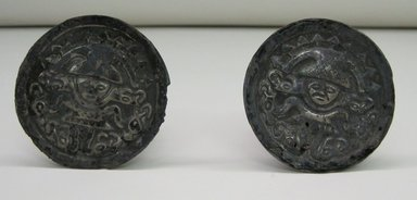 Chimú. Pair of Earplugs, 1000 - 1500. Silver, each (a+b): 1 3/4 x 2 3/8 in. (4.4 x 6 cm). Brooklyn Museum, Gift of the Ernest Erickson Foundation, Inc., 86.224.31a-b. Creative Commons-BY