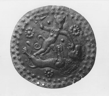 Ornament with Mythical Combat Scene, 9th century B.C.E. Bronze, 3 3/4 in. (9.5 cm). Brooklyn Museum, Gift of the Ernest Erickson Foundation, Inc., 86.226.39. Creative Commons-BY