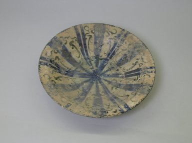 Bowl, 13th century. Ceramic, black and blue underglaze decoration, transparent      colorless glaze, 2 13/16 x 12 1/2 in. (7.2 x 31.8 cm). Brooklyn Museum, Gift of the Ernest Erickson Foundation, Inc., 86.227.12. Creative Commons-BY