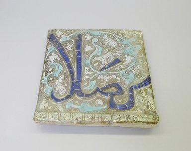 Tile, 13th century. Ceramic; fritware, molded, painted with cobalt-blue and turquoise under a transparent glaze, overglaze painted with luster, 9 3/8 x 1 1/16 x 10 15/16 in. (23.8 x 2.7 x 27.8 cm). Brooklyn Museum, Gift of the Ernest Erickson Foundation, Inc., 86.227.141. Creative Commons-BY