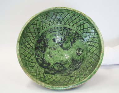 Bowl, 12th-13th century. Ceramic, champleve ware, transparent green glaze, 4 5/8 x 10 5/8 in. (11.8 x 27 cm). Brooklyn Museum, Gift of the Ernest Erickson Foundation, Inc., 86.227.179. Creative Commons-BY