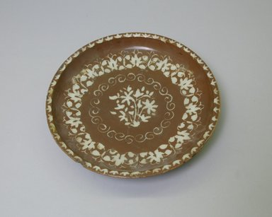 Plate, 18th century. Ceramic, brown slip, transparent colorless glaze, 1 7/8 x 9 1/8 in. (4.8 x 23.1 cm). Brooklyn Museum, Gift of the Ernest Erickson Foundation, Inc., 86.227.193. Creative Commons-BY