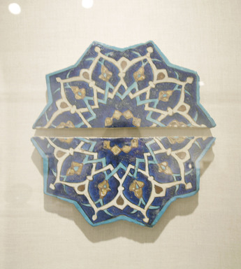 Ten-Pointed Star Tile, mid-15th century. Ceramic; fritware, painted in cobalt blue, turquoise, and opaque white glazes with manganese purple in the cuerda seca (dry-cord) technique, with leaf gilding, 14 1/2 x 1 1/4 x 15 in. (36.8 x 3.2 x 38.1 cm). Brooklyn Museum, Gift of the Ernest Erickson Foundation, Inc., 86.227.196a-b. Creative Commons-BY