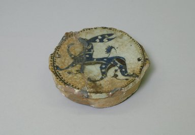 Fragment of a Bowl, 12th-13th century. Ceramic, blue, black and gray underglaze decoration, transparent colorless glaze, 1 5/16 x 5 1/16 in. (3.3 x 12.8 cm). Brooklyn Museum, Gift of the Ernest Erickson Foundation, Inc., 86.227.58. Creative Commons-BY