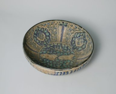 Bowl, early 14th century. Ceramic, blue, black and turquoise underglaze decoration, transparent colorless glaze, 3 3/8 x 8 1/8 in. (8.6 x 20.7 cm). Brooklyn Museum, Gift of the Ernest Erickson Foundation, Inc., 86.227.78. Creative Commons-BY