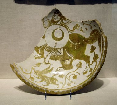 Fragment of a Bowl Depicting a Mounted Warrior, 11th century. Ceramic; earthenware, painted in luster on an opaque white glaze, 15 1/2 x 15 1/2in. (39.4 x 39.4cm). Brooklyn Museum, Gift of the Ernest Erickson Foundation, Inc., 86.227.83. Creative Commons-BY