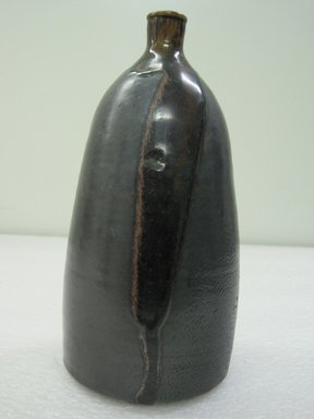 Tokkuri (Sake Bottle), 19th century. Glazed stoneware: possibly Takatori Ware, 10 x 4 3/4 in. (25.4 x 12.1 cm). Brooklyn Museum, GIft of Dr. and Mrs. Stanley L. Wallace, 86.84. Creative Commons-BY
