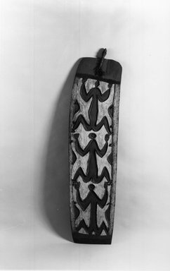 Asmat. Shield. Wood, pigment, 75 9/16 x 19 11/16 x 3 15/16 in. (192 x 50 x 10 cm). Brooklyn Museum, Gift of Gerald and Leona Shapiro, 88.191.4. Creative Commons-BY