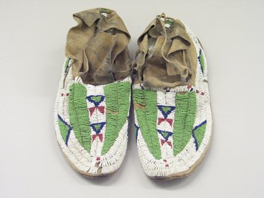 Arapaho (Native American). Man's Pair of Moccasins. Hide, beads, 10 1/4 x 3 15/16 in.  (26.0 x 10 cm). Brooklyn Museum, Brooklyn Museum Collection, X100a-b. Creative Commons-BY
