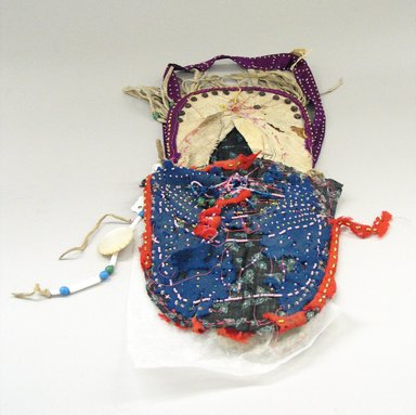 Plains (Native American). Miniature Cradle. Beads,deer  hide, stroud cloth, brass studs, wood, Brooklyn Museum, Brooklyn Museum Collection, X1126.11. Creative Commons-BY