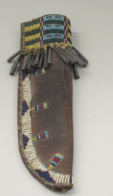 Cheyenne (Native American). Knife Case, Fourth Quarter 19th Century. Hide, glass beads, metal, sinew, 2 3/4 x 9 3/4 in. (7 x 24.8 cm). Brooklyn Museum, Brooklyn Museum Collection, X1176.3. Creative Commons-BY