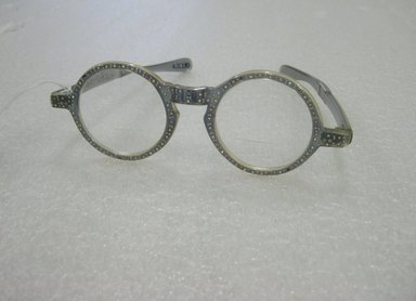 Eyeglasses, ca. 1965. Plastic, rhinestones, glass, metal, 2 x 5 7/8 x 5 3/4 in. (5.1 x 14.9 x 14.6 cm). Brooklyn Museum, Brooklyn Museum Collection, X1193.1. Creative Commons-BY