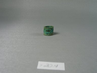Ring of Cylindrical Form. Faience, 9/16 x diam. 11/16 in. (1.4 x 1.7 cm). Brooklyn Museum, Brooklyn Museum Collection, X20.4. Creative Commons-BY