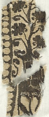 Coptic. Fragment of a Clavus Decoration from a Tunic. Flax, wool, Larger fragment: 4 1/4 x 2 in. (10.8 x 5.1 cm). Brooklyn Museum, Brooklyn Museum Collection, X935. Creative Commons-BY