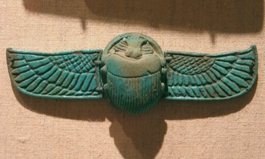 Winged Scarab, 664-332 B.C.E. Faience, glazed, 1/2 x 1 1/16 x 1 5/16 in. (1.2 x 2.7 x 3.3 cm). Brooklyn Museum, Gift of the Egypt Exploration Fund, 15.523. Creative Commons-BY