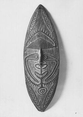 Elema. Shield  with Face Motif, late 19th-early 20th century. Painted wood, 45 x 15 in.  (114.3 x 38.1 cm). Brooklyn Museum, Brooklyn Museum Collection, X617. Creative Commons-BY