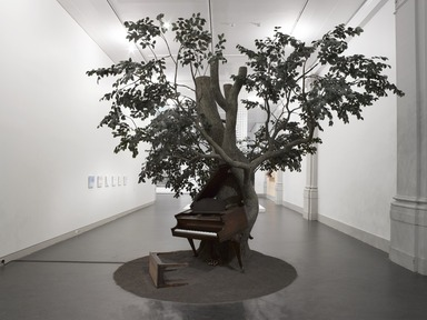 Sanford Biggers (American, born 1970). Blossom, 2007. Steel, silk, wood, MIDI player piano system, Zoopoxy, paint, dirt, modelling clay, polyurethane foam, 12 x 18 x 15 feet (365.9 x 548.8 x 457.3 cm). Brooklyn Museum, Purchase gift of Toby Devan Lewis, Charles and Amber Patton, and an anonymous donor, gift of the Contemporary Art Council, and the Mary Smith Dorward Fund, 2011.10. ©Sanford Biggers