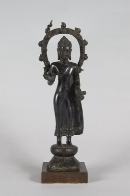 Standing Buddha, 7th-8th century. Bronze, 10 3/4 x 3 3/8 x 2 in.  (27.3 x 8.6 x 5.1 cm). Brooklyn Museum, Gift of Georgia and Michael de Havenon, 2013.101.3. Creative Commons-BY