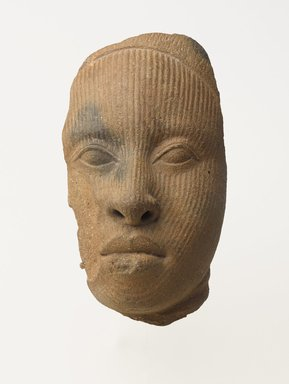 Yoruba. Fragment of a Head, 1100-1500. Terracotta, 6 x 3 1/4 x 3 3/4 in.  (15.2 x 8.3 x 9.5 cm). Brooklyn Museum, Private Collection, L54.5. Creative Commons-BY