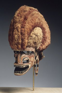 Mask (Tatanua), 19th Century. Wood, rattan, bark cloth, fiber, Turbo petholatus opercula, pigment, 15 1/4 x 9 x 12 in. (38.7 x 22.9 x 30.5 cm). Brooklyn Museum, Brooklyn Museum Collection, X1033. Creative Commons-BY